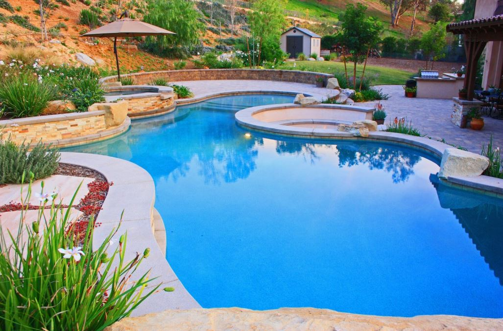 Planning landscaping around your inground swimming pool for Inground swimming pool designs