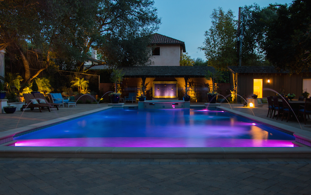 Swimming Pool at Dusk with Pool Lights and Water Jets