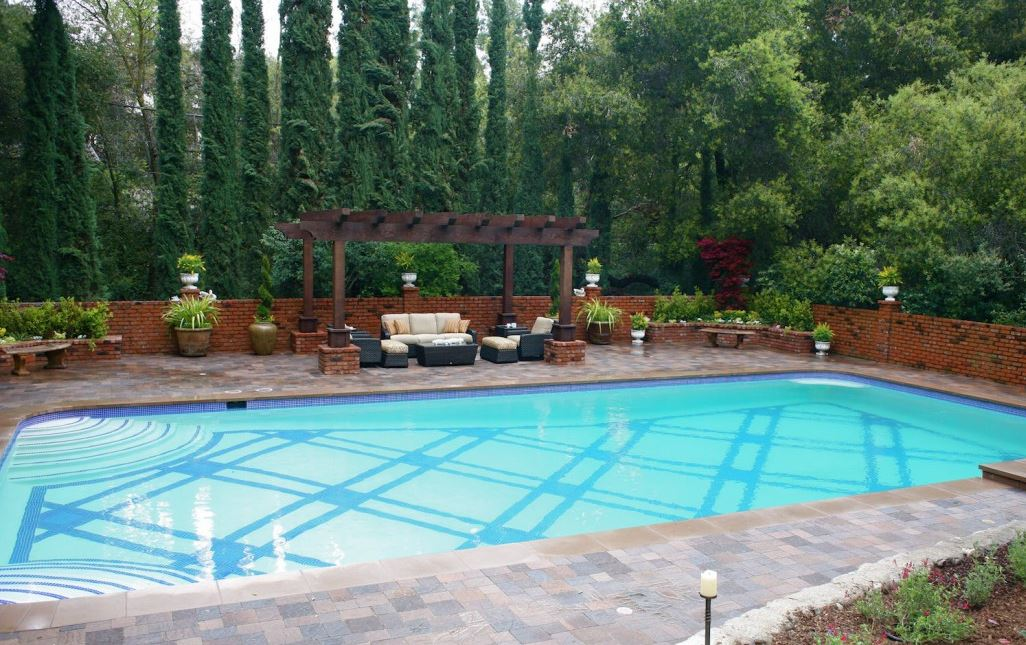 Planning landscaping around your inground swimming pool for Decor around swimming pool